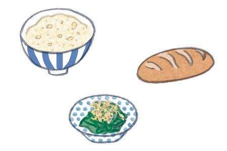 玄米、ライ麦パン、茹でた野菜の絵